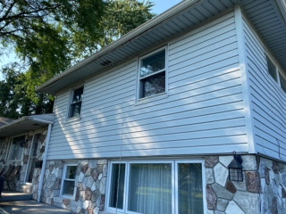 Clapboard vinyl siding with fully vented soffit new gutters and downspouts